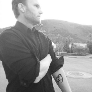 Black and white image of christopher and his duke silhouette tattoo